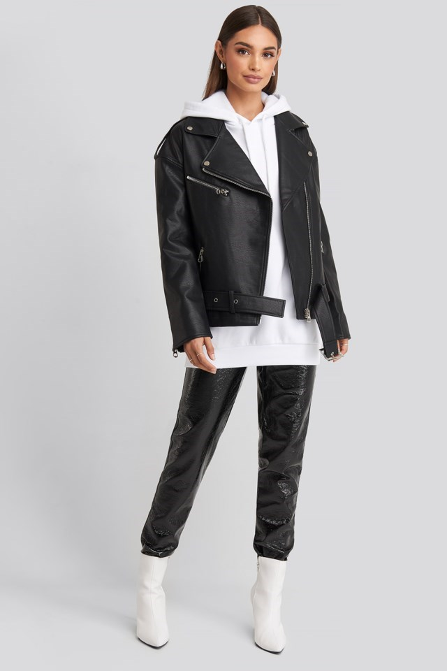 Style this jacket with an oversized hoodie, patent pants, boots, and silver accessories.