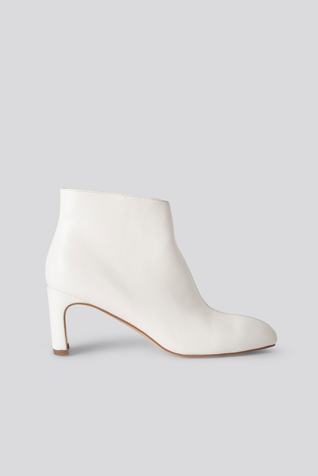 Low Slanted Shaft Booties White