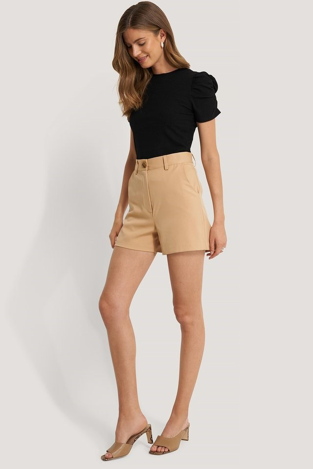 This outfit is perfect for when you need to look chic on a hot summer day! Just style this cute top with these shorts, a trendy pair of heels and some silver jewellery.