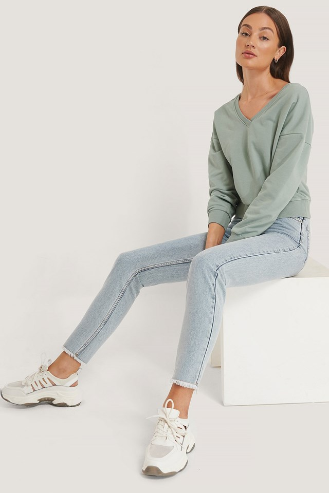 V-Neck Sweatshirt Outfit