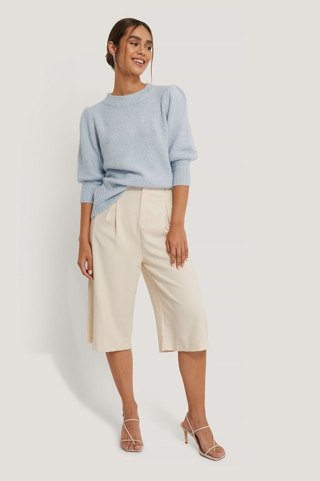Style this cute sweater, with silver-colored hoops, longer shorts, and a pair of strappy stilettos. For a cute and more dressed up look.