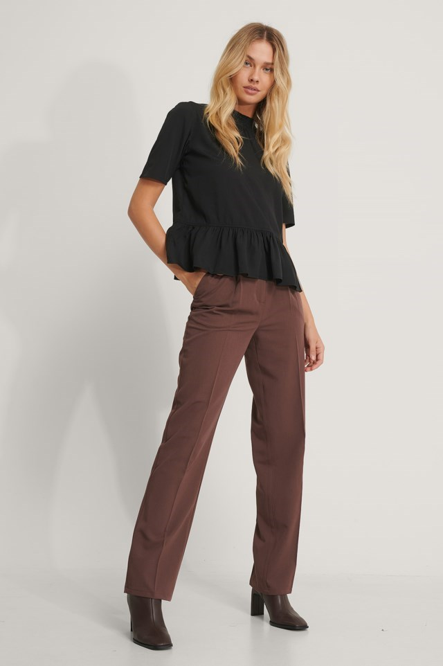 Style this top with these amazing trousers, earrings and heeled boots! A look that can be used at anytime!