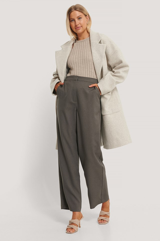 Wool Blend Dropped Shoulder Coat with Grey Suit Pants and Ribbed High Neck Knitted Sweater.