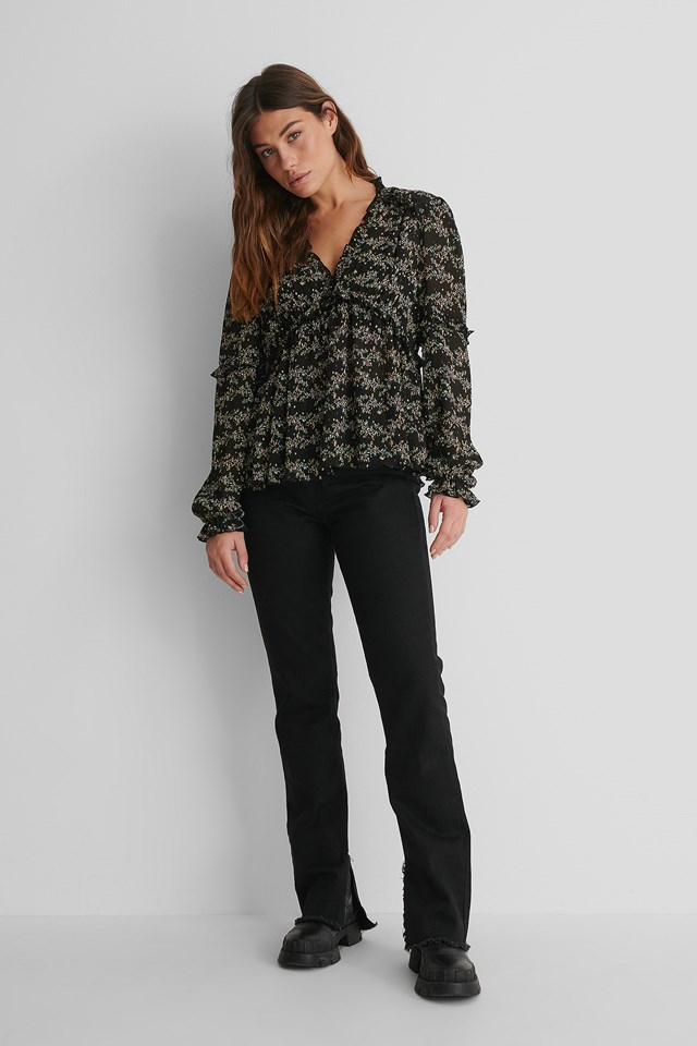 Structured Printed Frill Blouse with Black Slit Jeans and Boots.