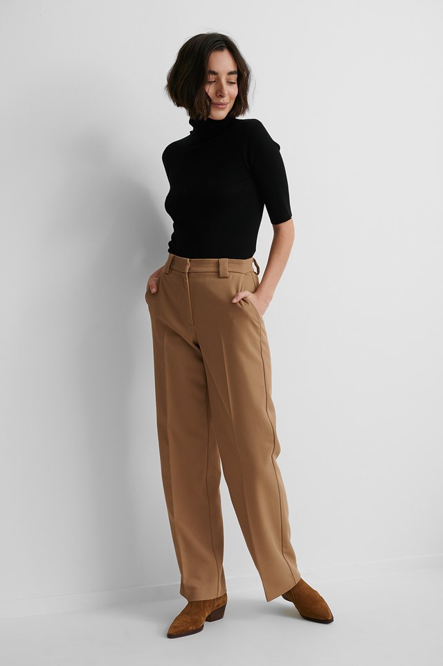 Pure Wool High Neck Knitted Sweater with Brown Suit Pants and Brown Boots.