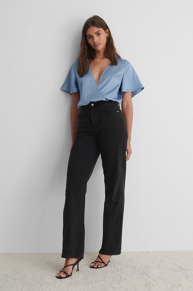 Wrap Over Short Sleeve Body with Black Jeans and Strappy Heels.