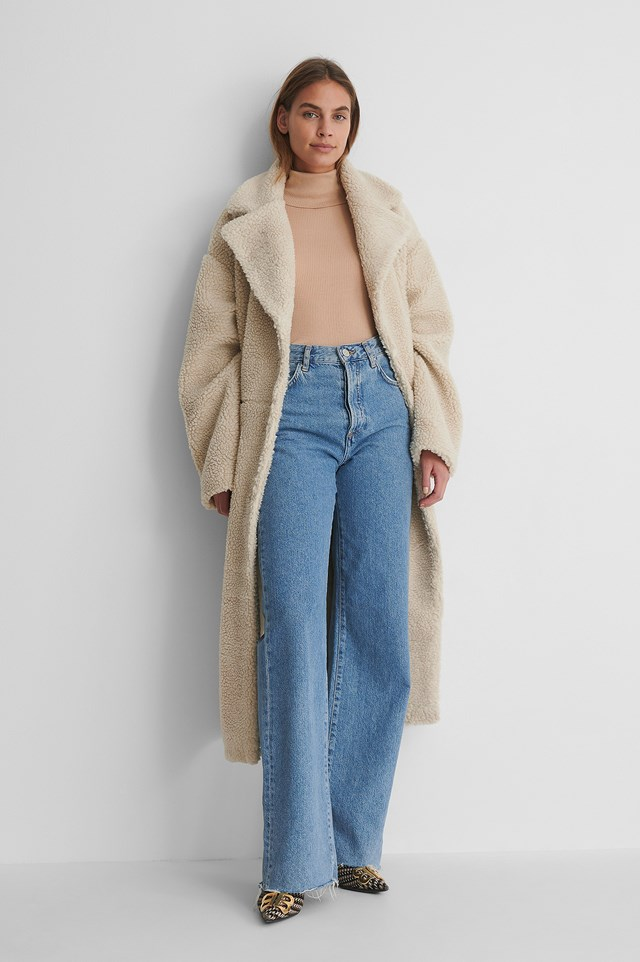 Pure Wool High Neck Knitted Sweater with Wide Denim and a Teddy Coat.