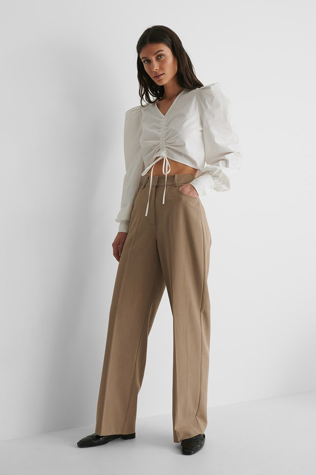 Cotton Drawstring Top with Suit Pants and Loafers.