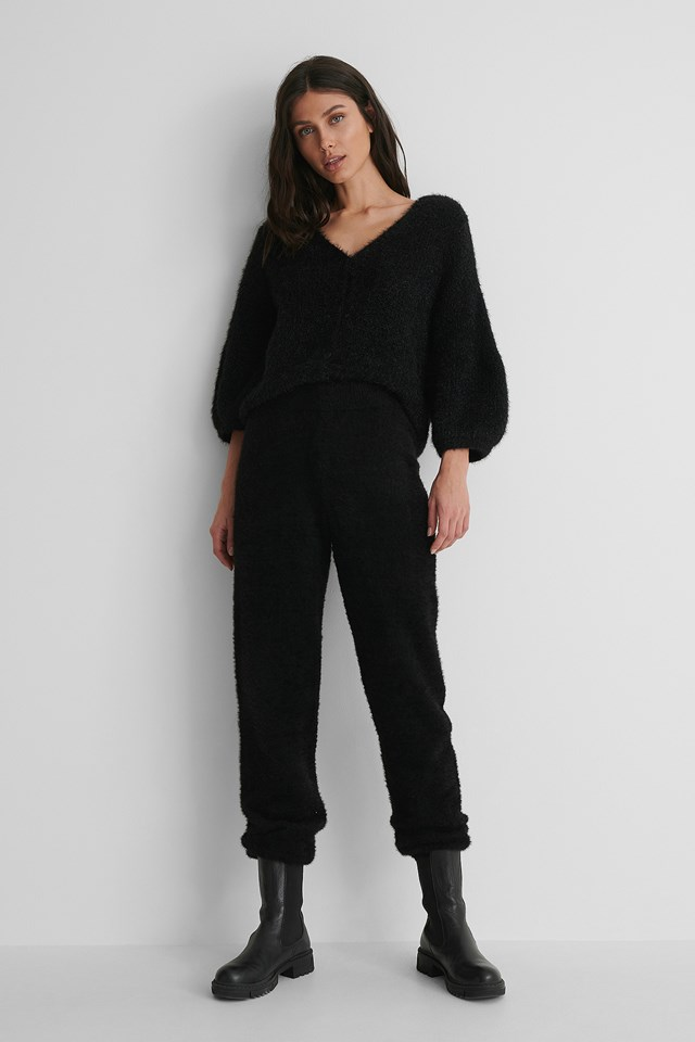 Balloon Sleeve Short Knitted Cardigan with Black Trousers.