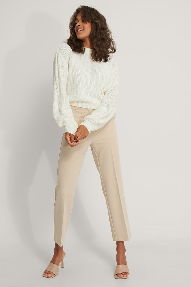 Balloon Sleeve Knitted Cropped Sweater with Beige Suit Pants.