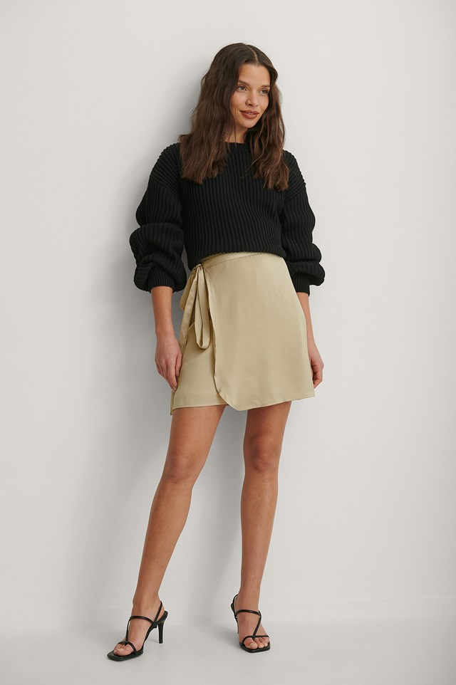 Knitted Oversized Sweater and Tie Waist Satin Skirt Outfit.