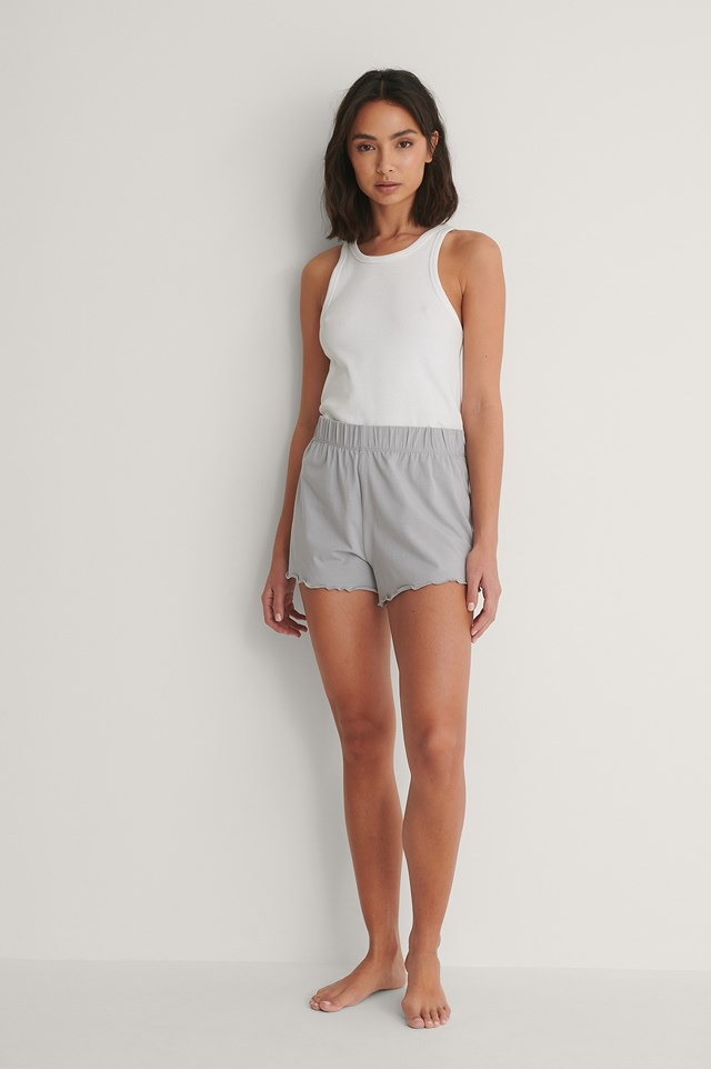 Frill Shorts with White Tank Top Outfit.