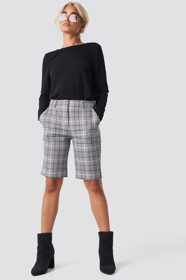 Black Top with Checked Pants.