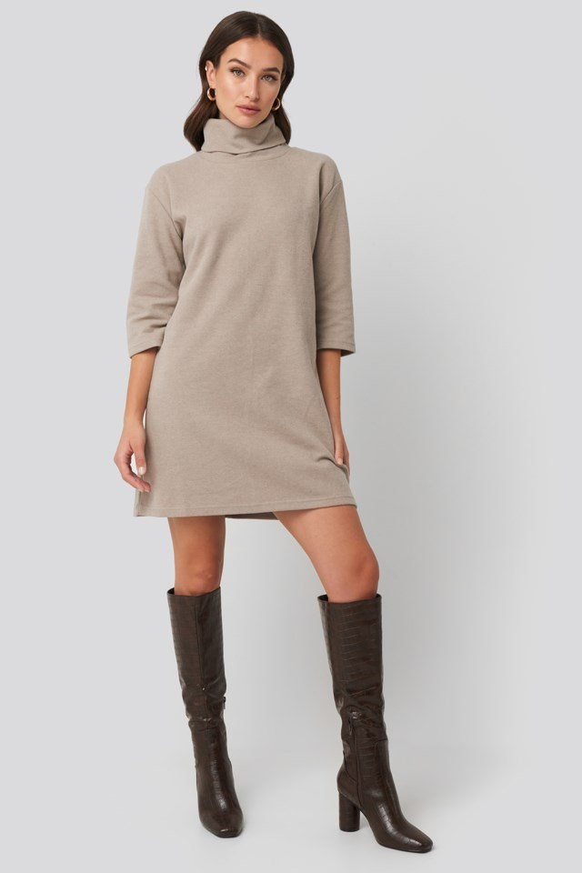 Style this dress with cowboy boots and a pair of gold-colored hoops.