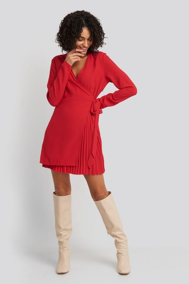 Style this dress with knee-high boots and a pair of silver-colored hoops.