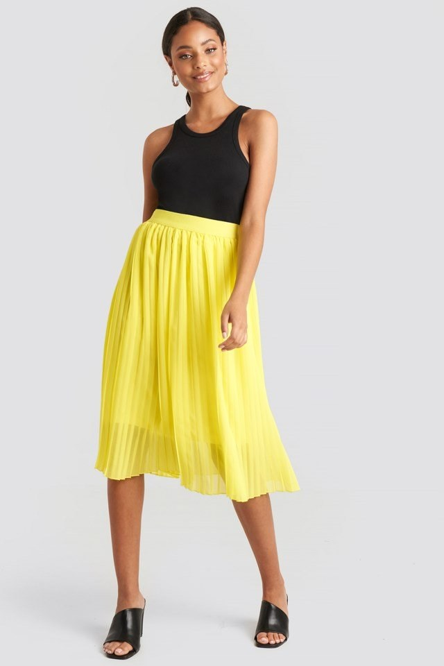 Style this skirt with a black top, heeled sandals and gold-colored hoops.