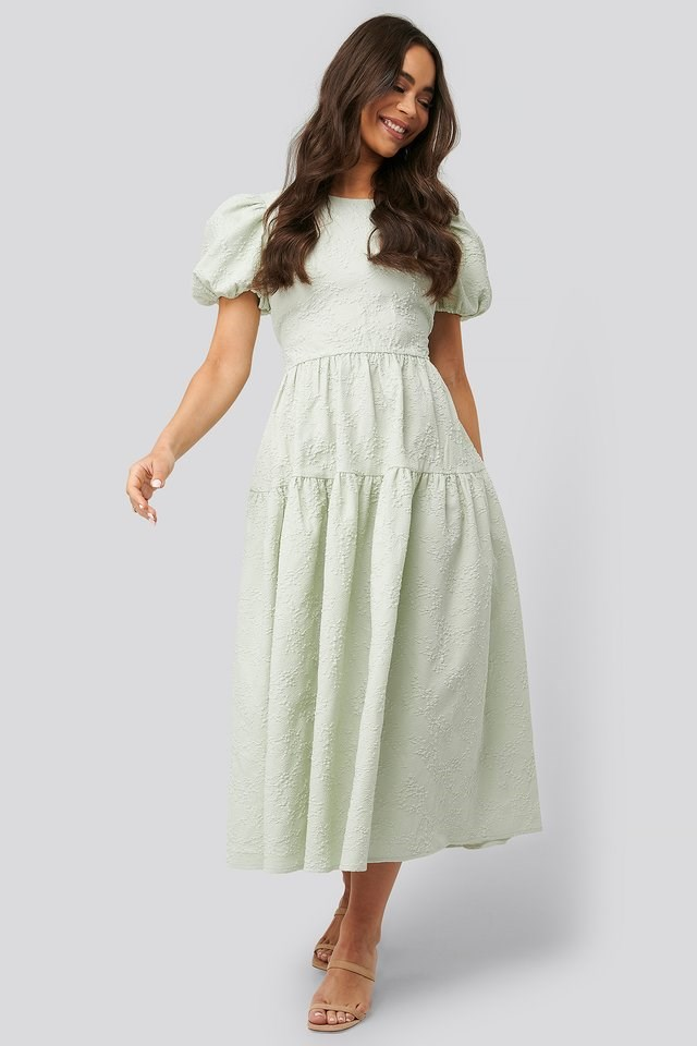 Style this cute boho-dress with a pair of high-heeled sandals and some gold-colored accessories for a trendy look.